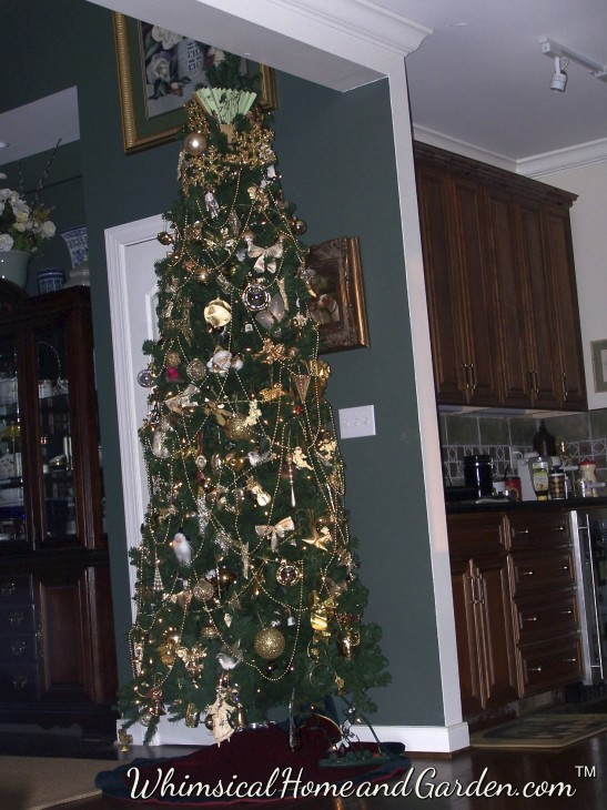 Christmas tree  located between dining room and wet bar........