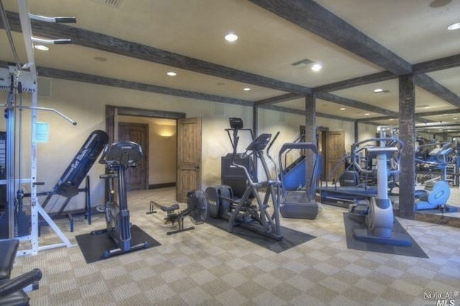 Even in the exercise room, the warm colors continue. The mirrors are framed with the same timbers as the ceiling!
