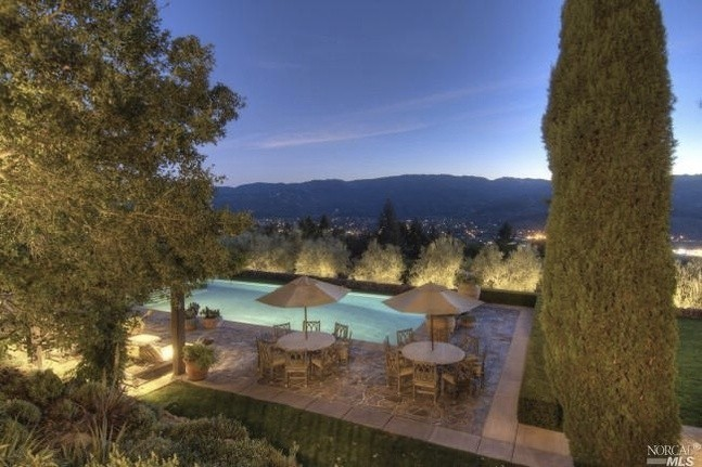 Even the lighting in this evening image is perfect. The stone surrounding the pool brings to mind the streets and sidewalks of Tuscan villages.