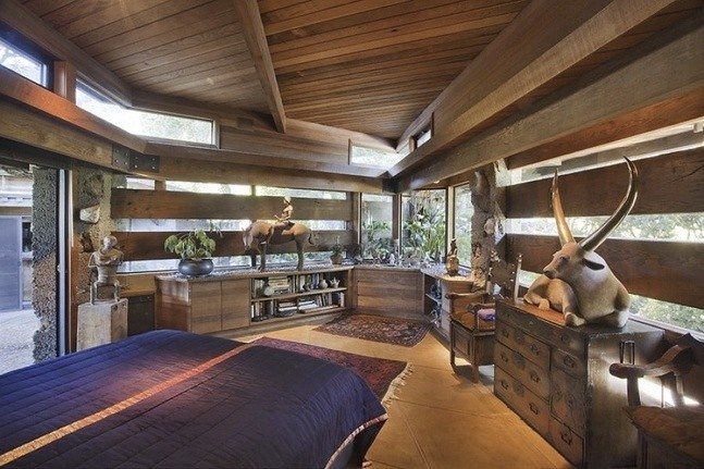 One of only 2 bedrooms, with the expected horizontal redwood with gaps of glass bringing the outdoors in beautifully. At night I bet it is amazing, especially from outside.