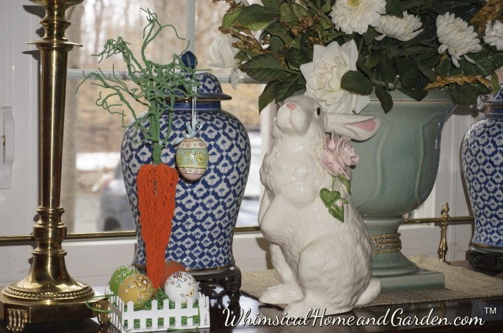 I bet you have never seen a carrot quite like this one! A 50 cent find at the thrift shop. I walked away from it at least three times, but something drew me back. Whimsy I guess. I added a few of my painted eggs and hung one from the carrot top. Bunny does not look amused.........