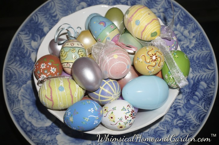 Simply placing some decorative eggs in a bowl and placing that onto a charger or larger decorative bowl on a table can announce spring is here just as nicely as more elaborate arrangements. Some of these eggs I painted eons ago with my friend SW. Happy memories also.