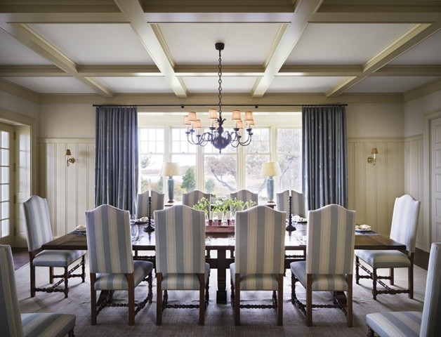 I love this dining room, with muted colors, views, and beautiful details.....the bead board, the coffered ceiling, large bank of windows (and french door and more windows to the left) allowing light to pour into the room. I would have to add 2 large pieces of Chinese porcelain to the left and right of the windows though! Can't help it.