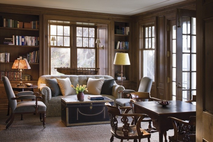The library with just a hint of nautical decor in the trunk, the wood boat in the window. The wood tones and the soft, muted colors are almost comforting.