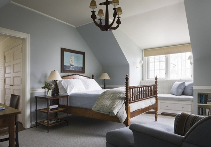 Another bedroom, same colors, same pretty bed, but a different chandelier, and a clipper ship work of art over the bed. Notice the repeating light fixtures over the inviting window seat.