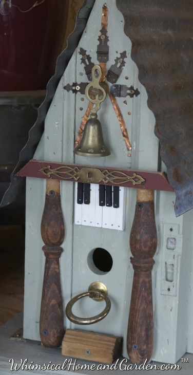 The bell was on an old porch screen door that announced that someone was either coming in, or going out!  You can see door trim molding that the stained wood furniture remnants sit on.
