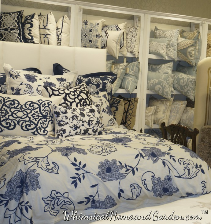 Pretty blue and white...you can see all the variations on the blue on the shelving behind this bed.