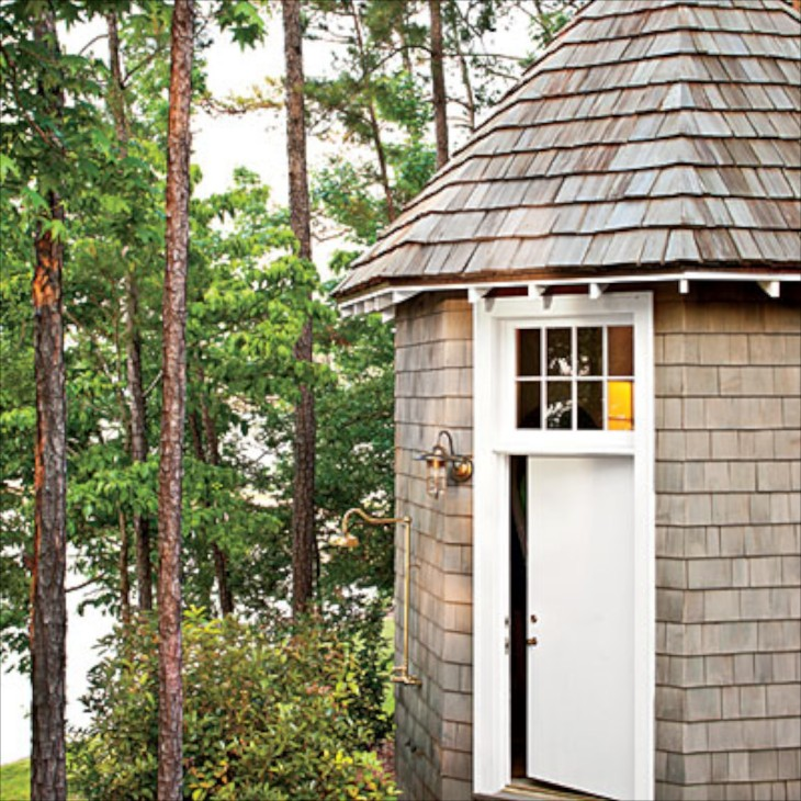 the outdoor shower attached to this french inspired storage house