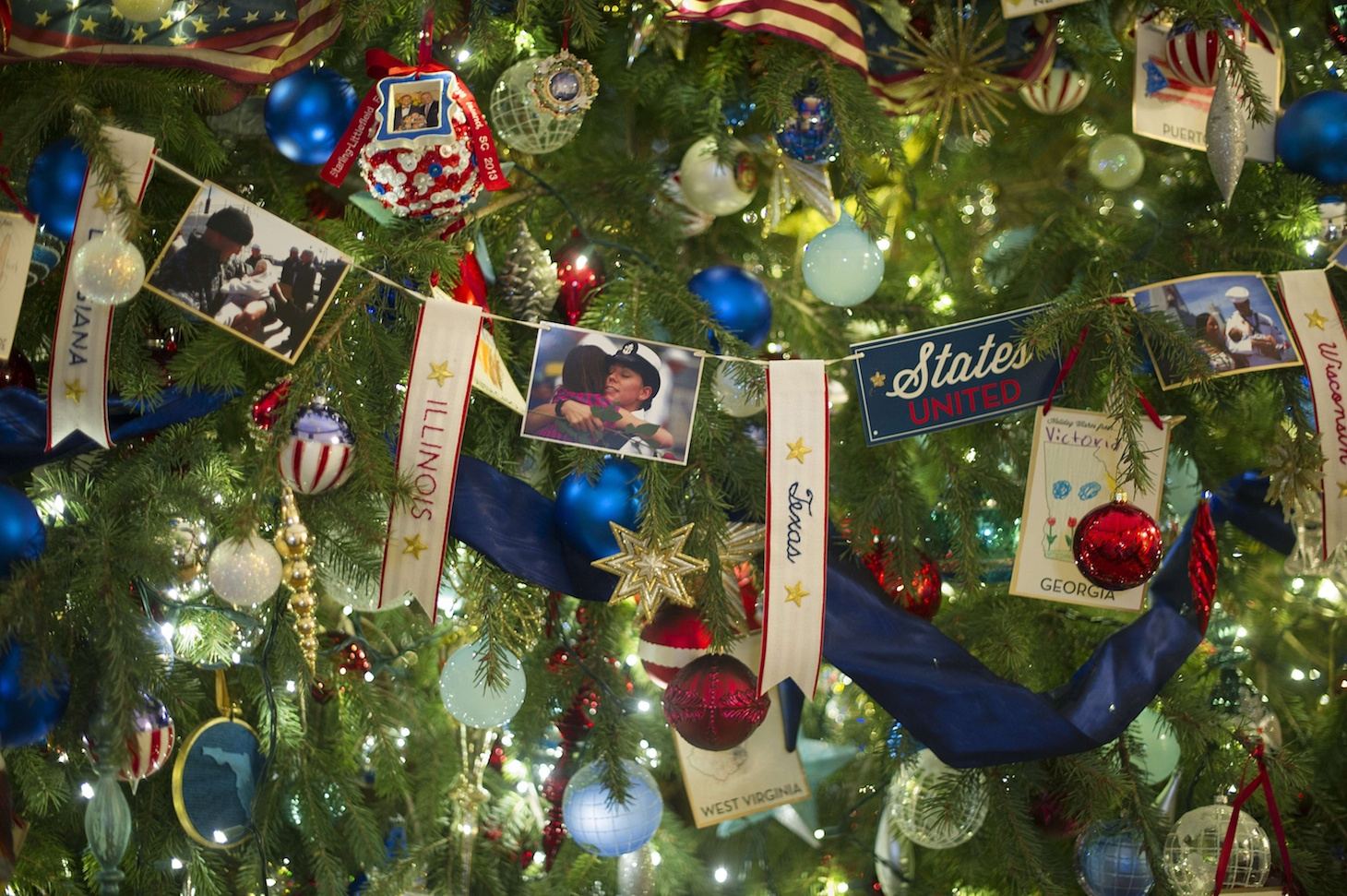 Decorations honoring military families hang upon the