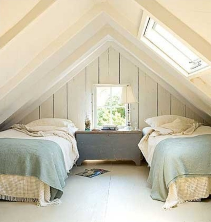 attic bedroom. Roof windows add lots of light and many open for additional ventilation  Everything is whitewashed the simple use blue paint on chest in Attic Bedrooms