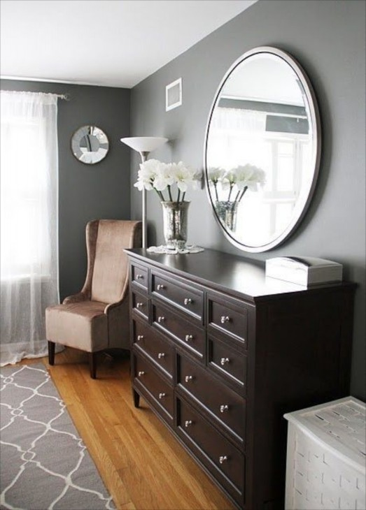 this round mirror looks so graceful on the gray walls and floating