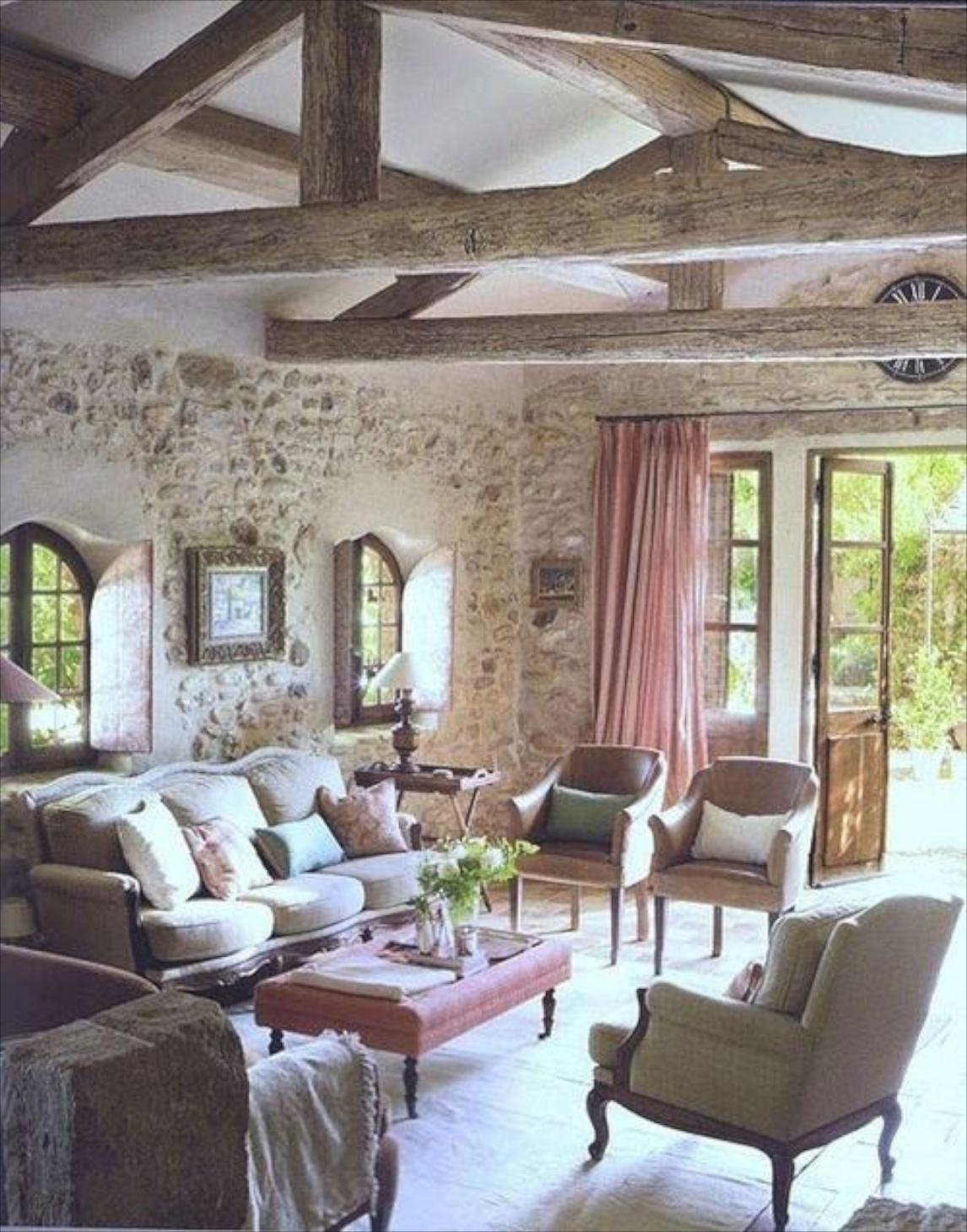 decorating with stone inside the home this elegant and sophisticated living room leans feminine despite the rustic wood trusses and solid rock walls touches of pink bring a sweet emphasis to