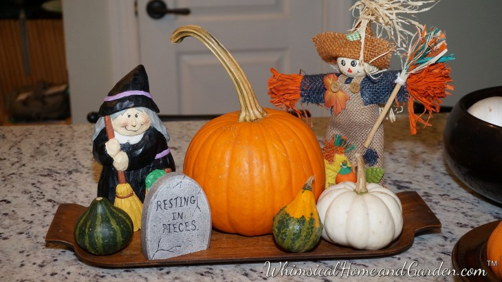 I have had this witch, scarecrow and a ghost (other photos) since forever. I like that they are friendly faces, and I look forward to unpacking them every year. This year they keep me company on my kitchen island.