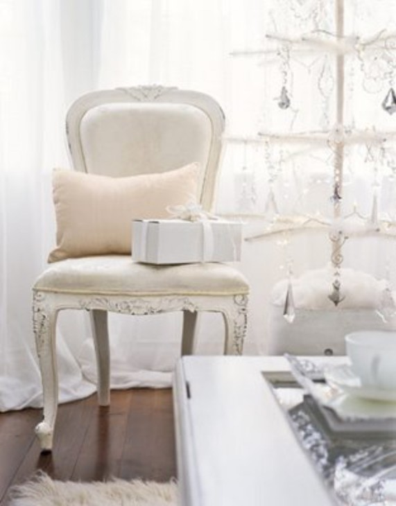 09_chair_white cream Christmas tree_Christmas Tree Decorating Ideas_Country Living_WHG